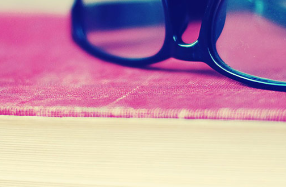 glasses laying on book